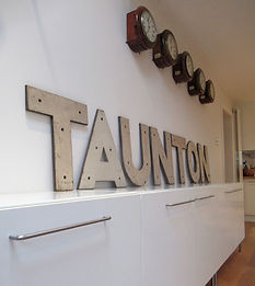 Taunton Station Running In sign
