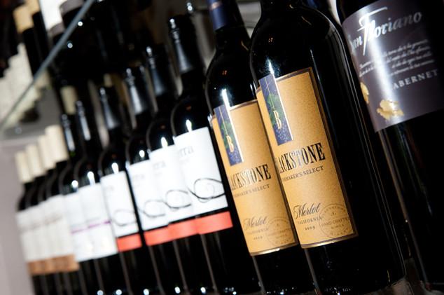Row of red wine bottles.jpg