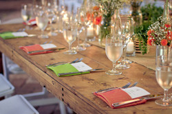 Wooden tables, napkins and chairs
