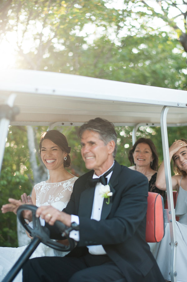 bride entering the ceremony in a golf cart