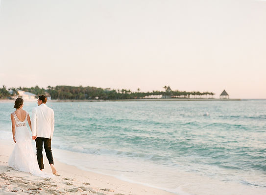 Bride and Groom walking by the beach in the bahamas