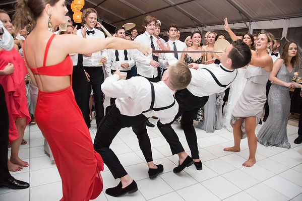 Groomsmen doing limbo