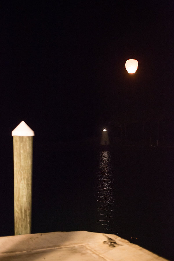Japanese lantern flying over a light house in the bahamas