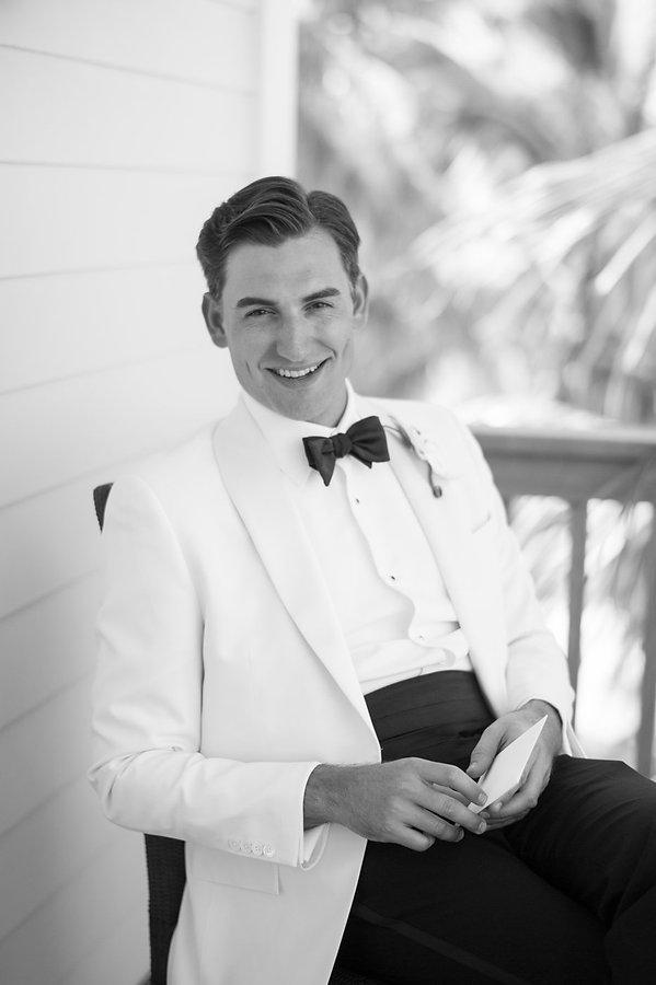 black adn white portrait of the groom