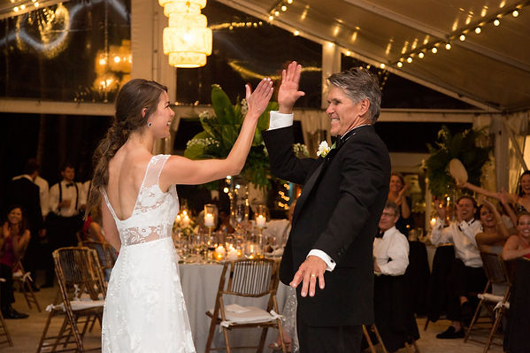 Father and daughter doing hi-five after their dance