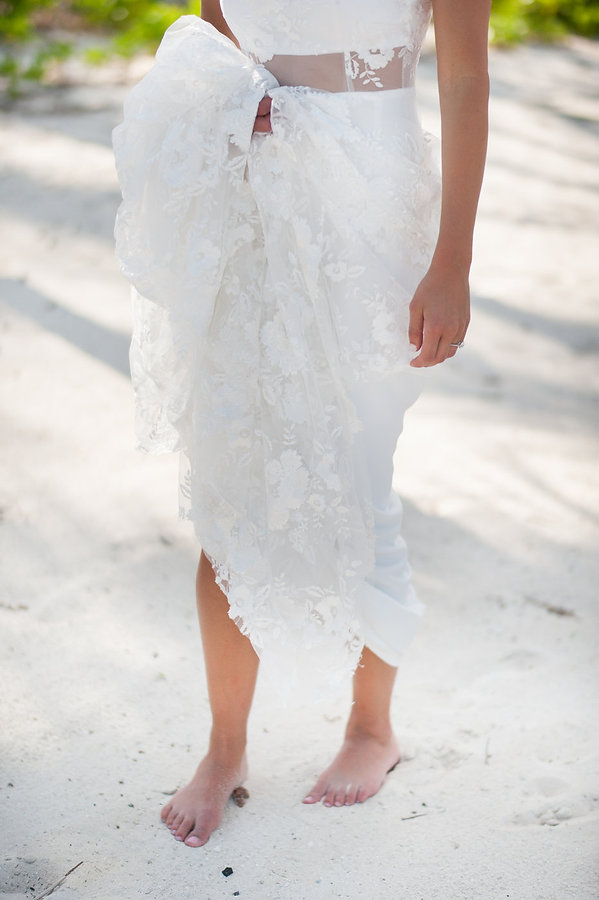 Bride Barefoot on the sand on her bahamas wedding