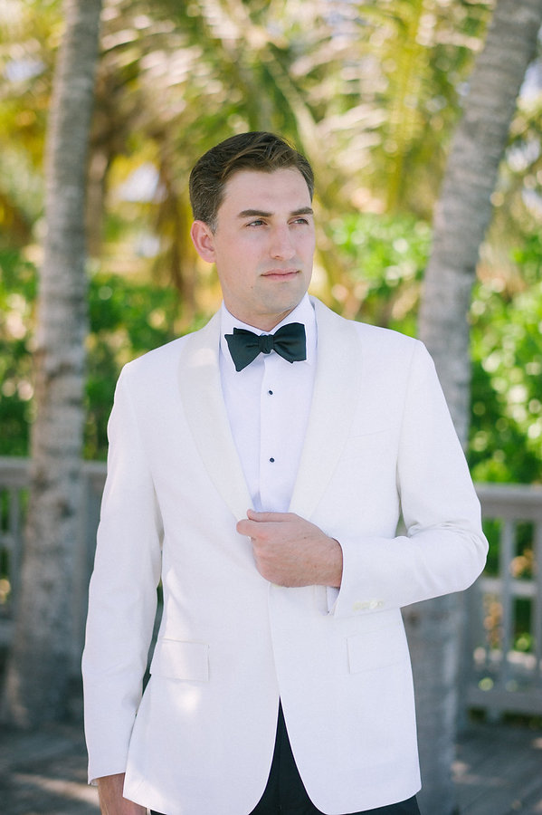 Grooms Beautiful white coat for the wedding