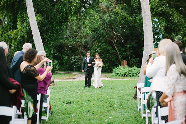 Bride walking down the aisle at the deering estate