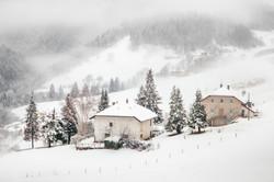 farmhouses in the snow