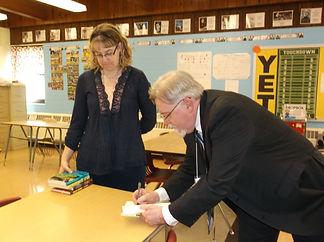 signing a copy of Stranded for Teri Kest
