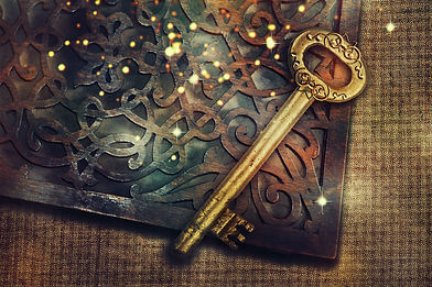 Magic book with gold vintage key.jpg
