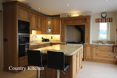 Kitchen with and island, country style kitchen with an island, oak kitchen with island, oak kitchen with island and granite worktops