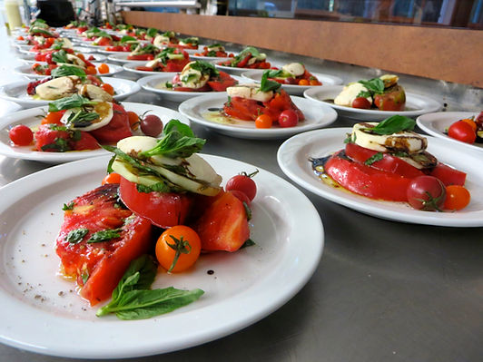 Local heairloom tomato, mozzarella, basil plated salad