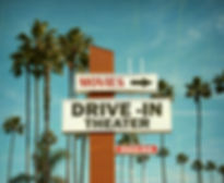 aged and worn vintage photo of drive in