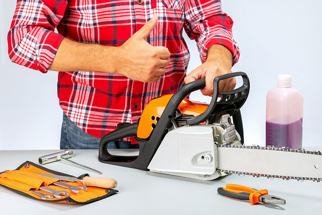 Repairman with chainsaw giving a thumbs up. Concept success in small business. Repair of c
