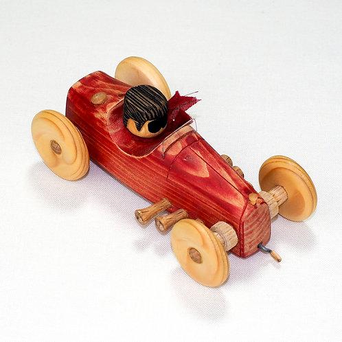 Matte rode auto, ventje met zwart haar