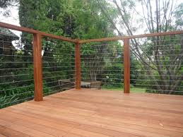 Timber posts and handrail with wires.jfi