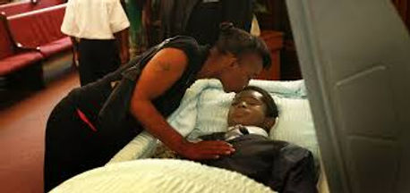 Young Black Man In Cakset with mom kissi