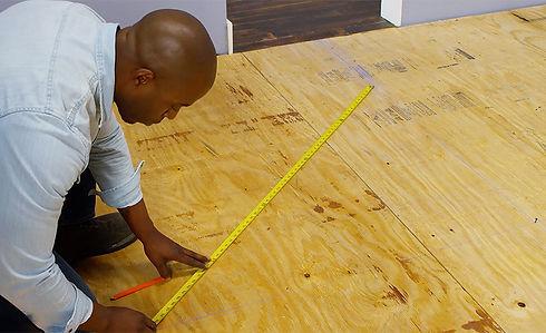 Black Man Laying Tile.jpg