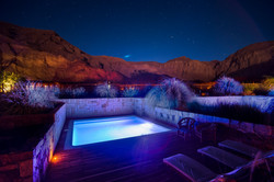 Outdoor swimming pool at night at Hotel