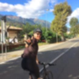 Cyclist waving, cycling through italy