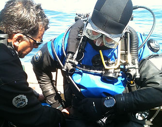 Underwater recovery and maintenance services, including hull cleaning, vehicle/item recovery, boat maintenance.