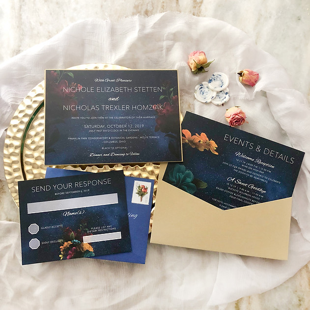 Moody romantic wedding invitation in navy and gold