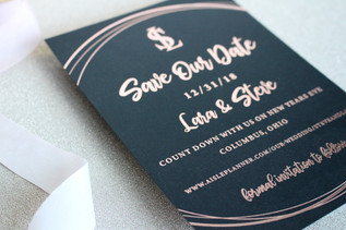 Black save the date with rose gold foiling