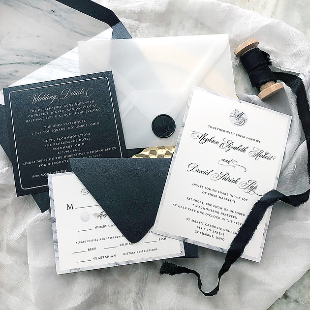 Classic black and white wedding invitation with vellum envelope
