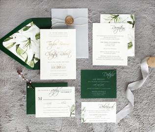 Botanical green floral wedding invitation with vellum wrap
