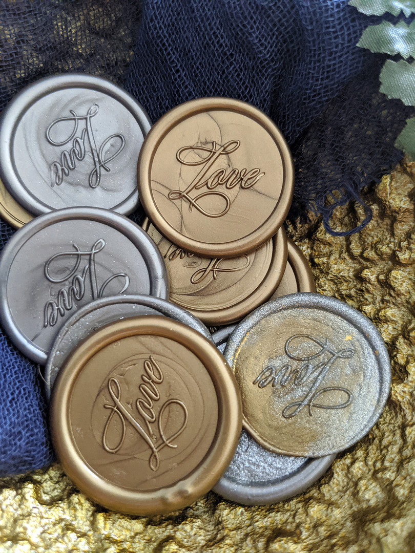 silver and gold wax seals