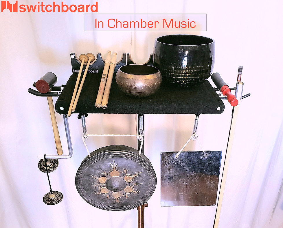 Switchboard in Chamber Music - LEFT: Chime mallet on 2 Fat hooks; TOP: Latex mallets, Moleskin swizzles, singing bowl, temple gong; RIGHT: temple gong beater and bass bow on 2 Skinny hooks; BOTTOM: Finger cymbals on L-hook, Thai gong on 2 J-hooks, and bell plate on 1 J-hook.