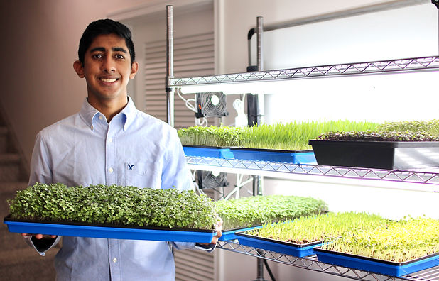 Raghu With Microgreens.jpeg