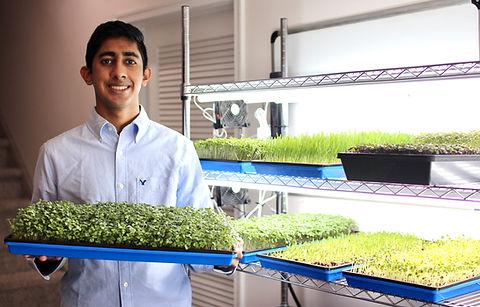 Raghu With Microgreens.jpeg