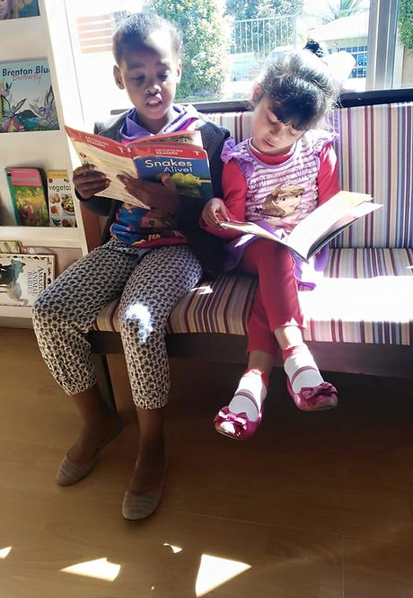 two Montessori childern reading