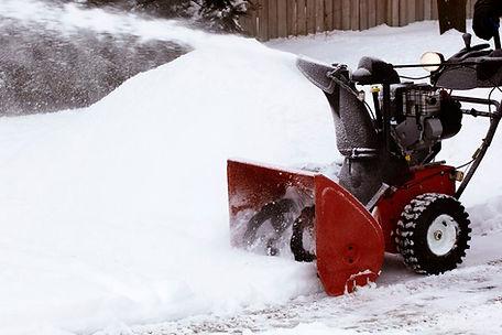 Snowblowers clear sidewalks