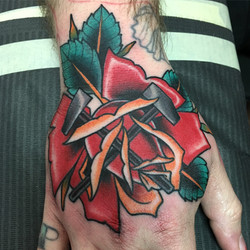 Hand Rose Tattoo by Chris Astrologo