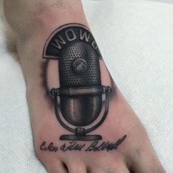 Black And Grey Microphone Tattoo