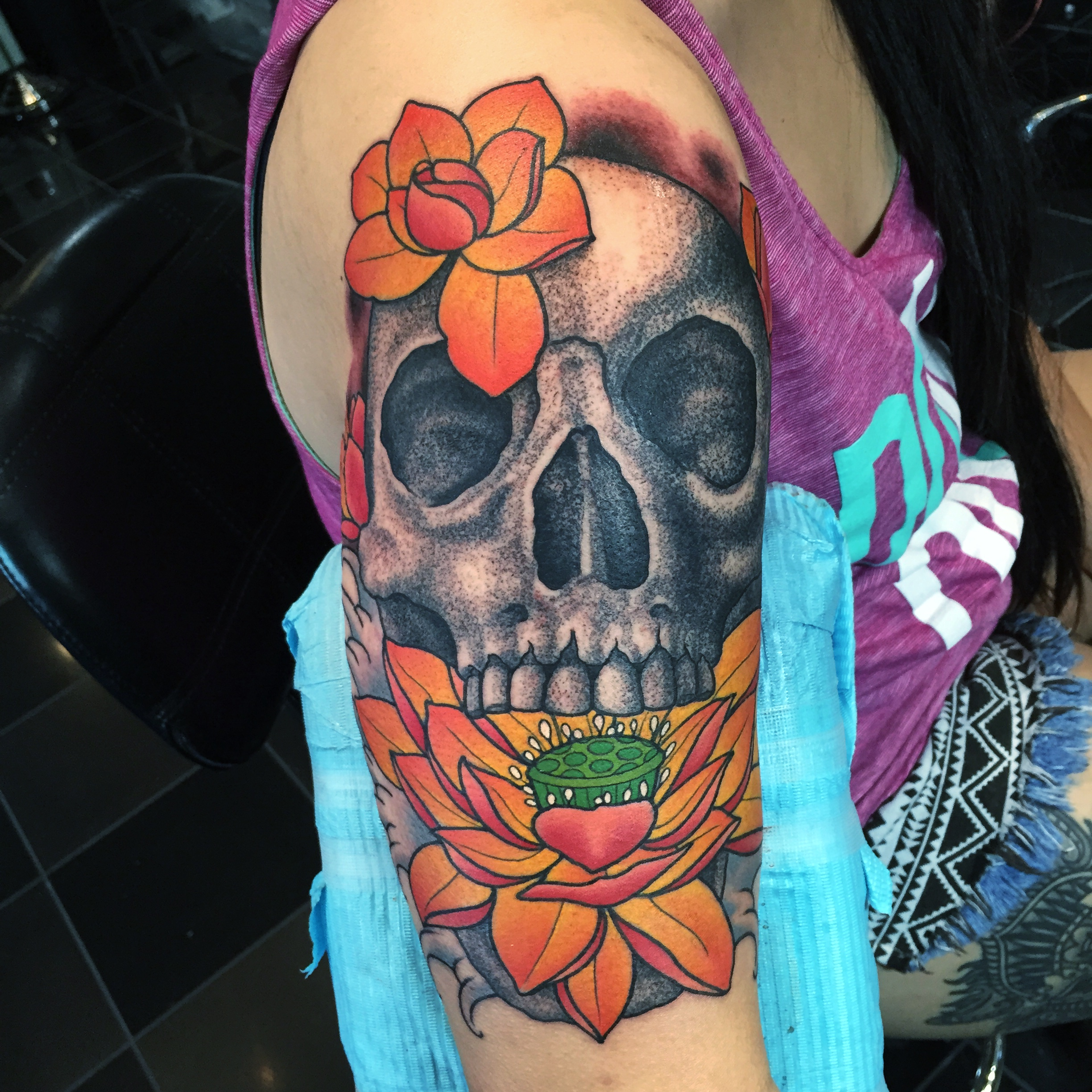 Black And Grey Skull + Lotus Tattoo