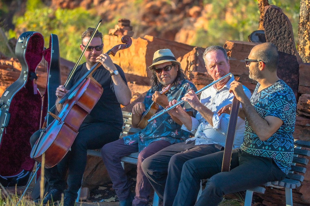Sonus3 musicians playing outside in the rocky Kununurra landscape