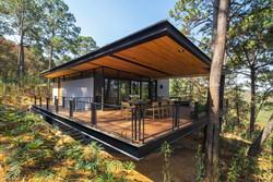 Broissin-green-roofed-Irekua-Anatani-house-1-1-889x595