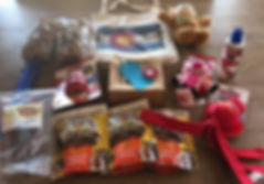 A pile of various dog treats and toys
