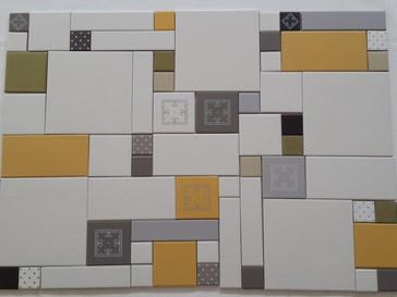 משחק מעניין של צורות וצבעים לקיר שמאחורי הכיריים