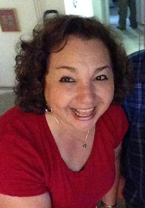 Leslie in red shirt smiling.jpg