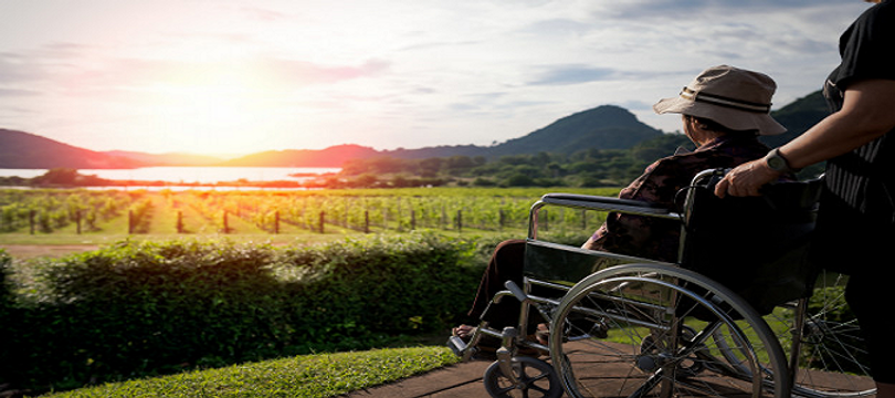 caregiver-with-elderly-woman-sunset-crop