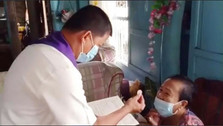 Priest visits and blesses sick and elderly