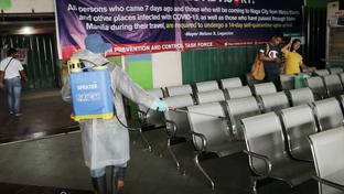 An employee sprays disinfectant