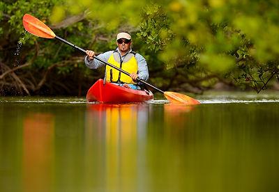 bigstock-Man-Kayaking-In-Florida-5747884