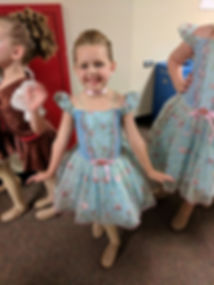 girl smiling with dance costume