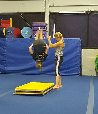 Gymnast learning a back tuck